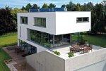 Dom jednorodzinny z oknami, drzwiami i kolektorami słonecznymi Schüco